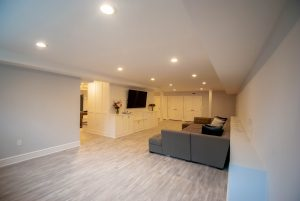 custom basement remodel auburn landing custom builder living room tv couch