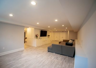 custom basement remodel auburn landing custom builder living room tv couch