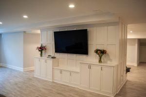 custom basement remodel auburn landing custom builder home tv cabinets paneling
