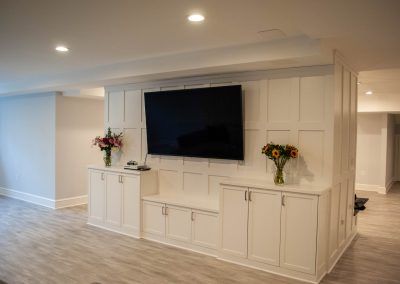 custom basement remodel auburn landing custom builder home tv cabinets paneling